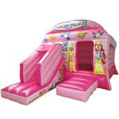 a pink princess themed bouncy castle with a slide at the front